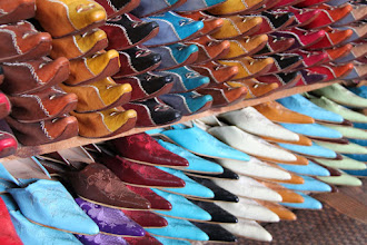 Photo: Handmade shoes stacked from floor to ceiling