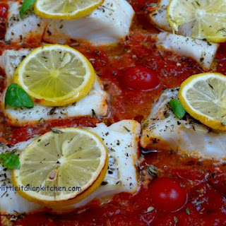 Baked Fish with tomatoes and herbs.