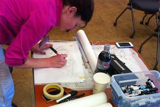 Photo: Urban designer Rebekah Kik works on a 3-D sketch of the final proposal.