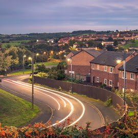 Estate at Dusk by Darrell Evans - Buildings & Architecture Homes ( sidewalk, sky, yorkshire, dusk, flowers & plants, estate, flora, clouds, community, streetlight, building, outdoor, path, uk, grass, street, homes, evening, no people, landscape, lights, architecture )