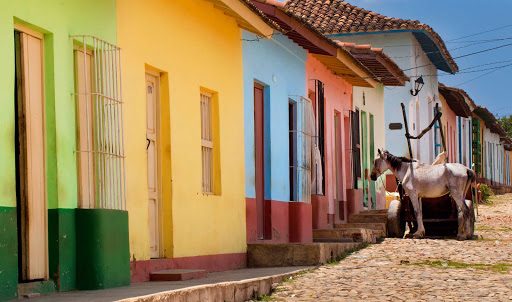 Cuba-Street-with-Small-Colorful-Homes-and-Donkey_01.jpg - Colorful homes in the town of Trinidad, Cuba.