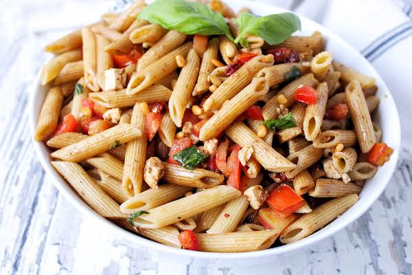 A Large Bowl Of Bruschetta Pasta Salad.