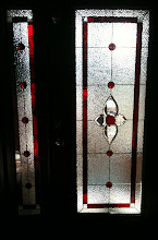 Photo: Red glass entry, stained glass, leaded glass, beautiful, custom, handmade, doorlite, sideline, front entry, beveled, bevels, Fayetteville, lake, privacy, replaced clear glass.