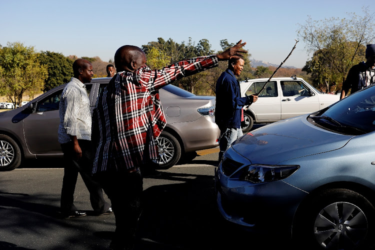A group of app-based taxi drivers protest in Johannesburg on Monday. Picture: ALON SKUY