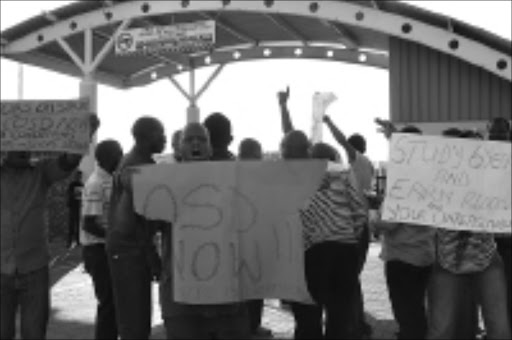 AXED: Dismissed doctors at the Bophelong Hospital in the North West show their anger at the decision. Circa 04/2009. © Unknown. Pic. Otsile Tlape.