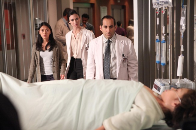 """Photo: HOUSE:  Taub (Peter Jacobson, second from R), Adams (Odette Annable, second from L) and their young patient's mother (guest star Samantha Cutaran, L) witness her son (guest star Riley Lennon Nice, R) showing strange syptoms in the """"Body and Soul"""" episode of HOUSE airing Monday, April 23 (9:00-10:00 PM ET/PT) on FOX. ©2012 Fox Broadcasting Co.  Cr:  Adam Taylor/FOX"""