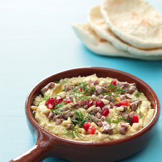 Hummus With Seared Lamb and Toasted Pinenuts.