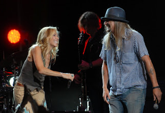 Photo: CLARKSTON, MI - AUGUST 12: Sheryl Crow and Kid Rock perform during the Palace Sports and Entertainment's Come Together Celebration concert at the DTE Energy Music Theater on August 12, 2012 in Clarkston, Michigan. (Photo by Paul Warner/Getty Images)