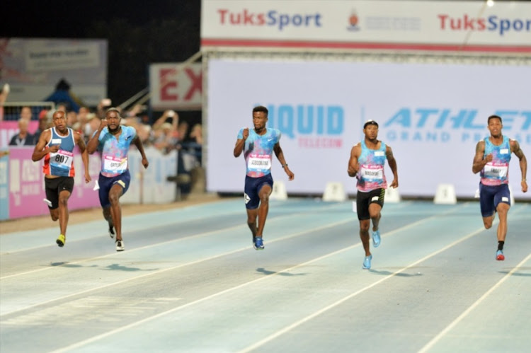 South African Anaso Jobodwana wins Final Men Senior 150m against American sprinter Justin Gatlin and Simon Magakwe during the 2018 Liquid Telecom Athletix Grand Prix Series at Tuks Stadium on March 08, 2018 in Pretoria.
