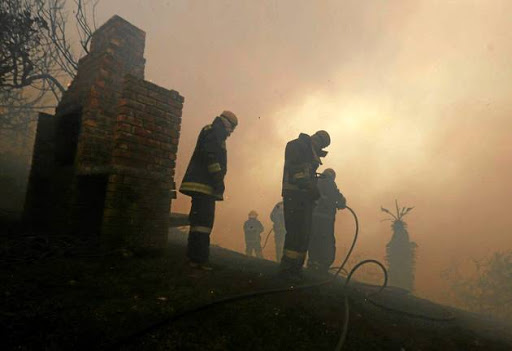 DEDICATION NOT ENOUGH: Firefighters have struggled for almost a week to put out the deadly fires in Knysna.