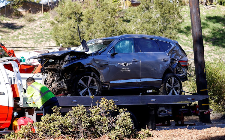 Tiger Woods' damaged car is towed away after he was involved in a car crash near Los Angeles on February 23 2021.