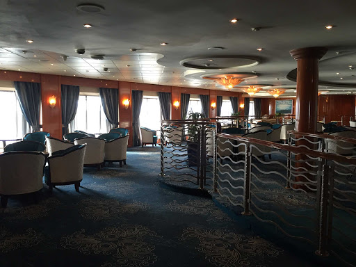 The newly remodeled Ocean Bar on Prinsendam features a bar and dance floor on deck 3.