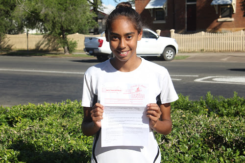 High jumper Dianne Roberts proudly holds her invitation to the Sports Travel Australia Track and Field Tour of Australia.