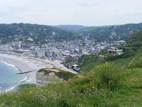 Photo: From higher up, we get a good view of the town and beach. Typical of this part of Normandy, the latter is stone rather than sand.