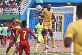 Photo: Jacques TUYISENGE (9) rises for the cross from the corenr kick [Rwanda Vs Ghana AFCON2017 Qualifier, 5 Sep 2015 in Kigali, Rwanda.  Photo © Darren McKinstry 2015