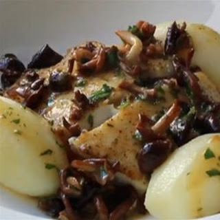 Pan-Roasted Halibut with Mushroom Butter Sauce.
