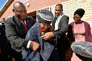 President Cyril Ramaphosa and  Chief Mandla Zwelivelile Mandela  hand over blankets to the elderly to mark the opening of the clinic to the public at Mvezo village, Eastern Cape.