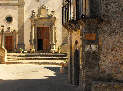 One of the film shooting locations for The Godfather in Forza d'Agro, Sicily. It's the scene when Vito escapes to America hidden in a donkey, while Don Ciccio's men threaten the neighbors.
