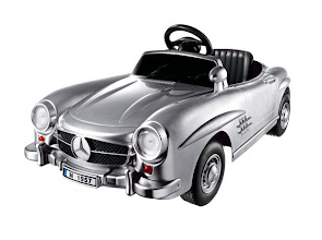 Photo: DEXTON Silver Mercedes- Benz 300SL battery-operated ride-on sports car. 18.43″ high x 25.75″ wide x 49.2″ long. For ages 3 and up. Authentically styled with forward and reverse gears, LED headlights, horn sounds and chrome front grille. $450. Imported. Seventh Floor. 212 872 2686