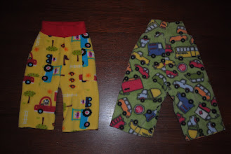 Photo: Left- Farm Longies size Small. No extra layer of fleece in the wetzone. Cute Cargo Pockets on the sides. $10ppd. Right, Little Comet Tails Home Sew Pattern Longies (Traffic Print) $10ppd  These Pants (on the right only) are UNHEMMED. This is because I had a very skinny and tall son. He grew in length but not in waist size, so I left his pants unhemmed so I could roll them up and then unroll as he grew. I can hem them for you before they go out if you'd like. Not a big deal :)