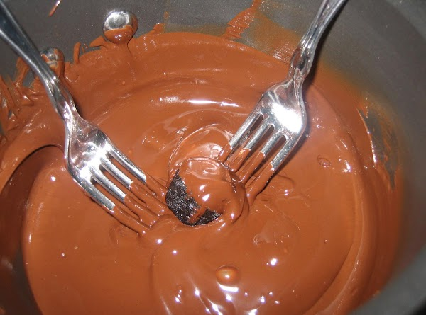 In small saucepan, melt mint chocolate chips together with shortening.  Using 2 forks,...