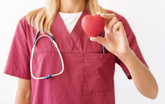 Front view of female doctor holding heart shape Free Photo