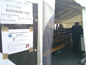 Photo: hardware tent with posters for workshops