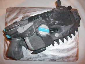 """Photo: A """"Gears of War"""" Lancer cake - a geeky themed cake of a chainsaw-gun"""