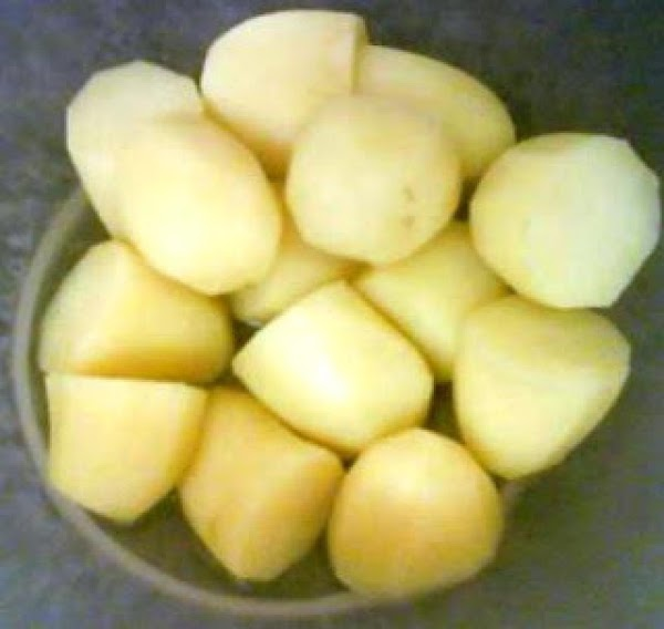 Peel, cut and boil potatoes.  Don't boil them too long.  You don't...