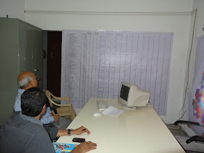 Photo: Member, IEA reviewing the state wide list of constituencies management chart