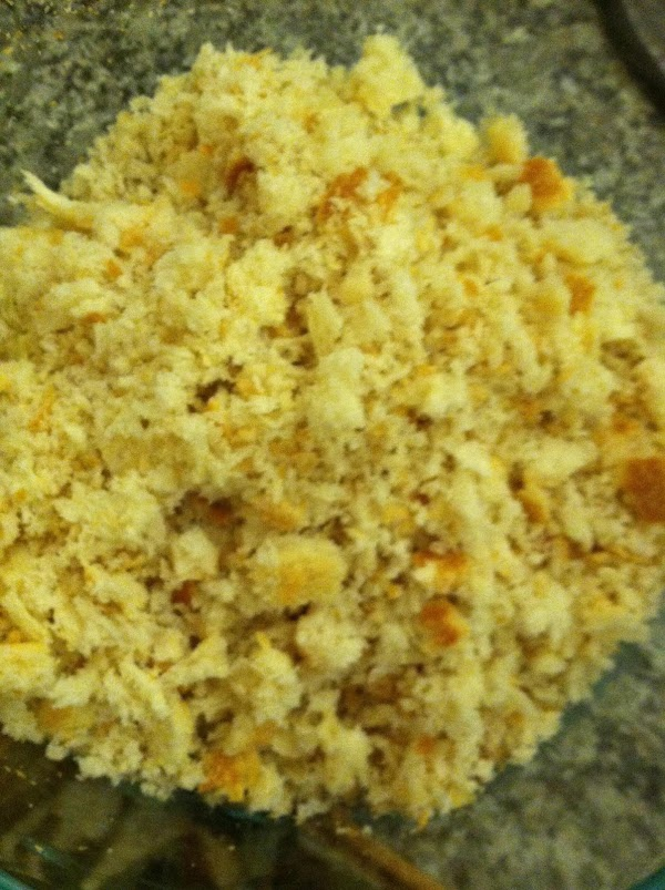 Butter a casserole dish. Make  bread crumbs: place torn french bread in food...