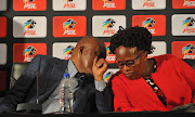 Premier Soccer League chairman Irvin Khoza (L) in a discussion with acting chief executive Manto Madlala (R) during a press conference at the League's headquarters in Parktown, Johannesburg on Tuesday April 9 2019.