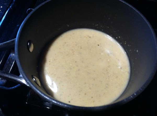 IN A SMALL SAUCEPAN ADD 1 TBLSPN OF VEG OIL TO THAT ADD FLOUR...