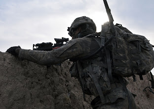 Photo: U.S. Army Pvt. 1st Class Antonio Hawkins, Bulldog Troop, White Platoon, looks through his rifle scope to scan for insurgents during a reconnaissance patrol near Combat Outpost Delorean, Bala Murghab, Baghdis Province, Afghanistan Jan. 9, 2011. Hawkins was one of several Soldiers deployed from 1st Brigade, 4th Infantry Division, Fort Carson, Colo., who partook in the patrol. Hawkins' was part of the team that build COP Delorean and frequently comes under attack defending it. (U.S. Air Force photo/Tech. Sgt. Kevin Wallace)