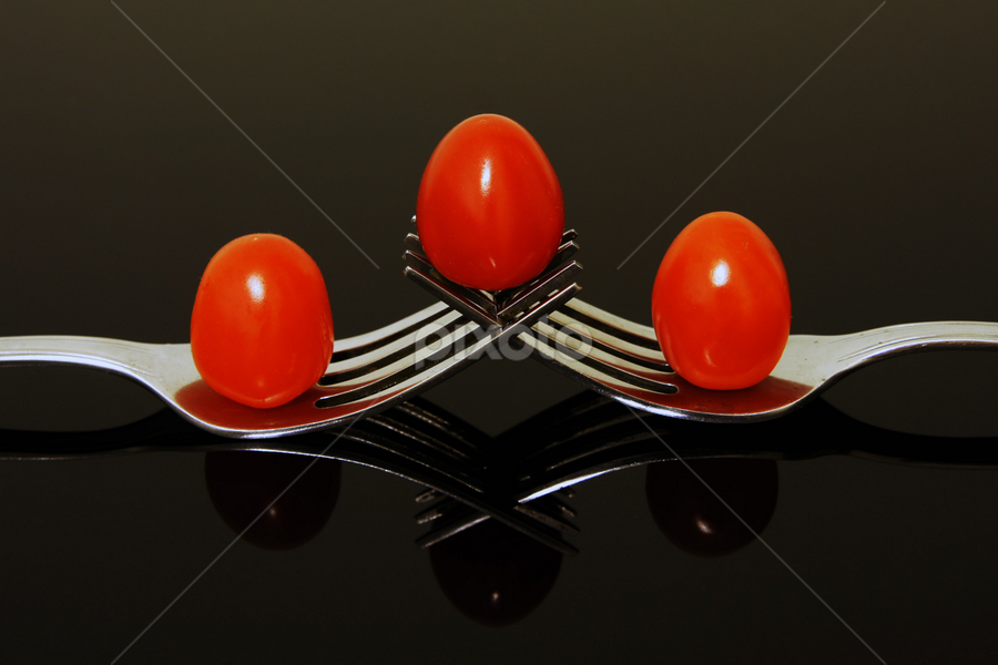 Forks & Tomatoes by Jenny Zhang - Food & Drink Fruits & Vegetables ( reflection, recipe, tomato, spice, matte, object, restaurant, close, farm, nature, fresh, ingredient, cooking, lunch, closeup, black, shiny, isolated, symbol, texture, pwcfruit, green, menu, agriculture, kitchen, dinner, organic, red, herb, food, background, ripe, healthy, freshness, eat, group, vegetable )