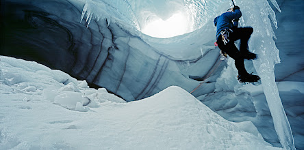 Photo: Thorsten Henn - Iceclimber climbing up in a Icecave on Langjokull glacier in Iceland