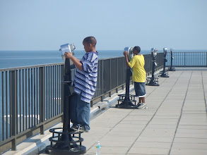 Photo: Jihad & Miles looking through the binoculars @ the Pier