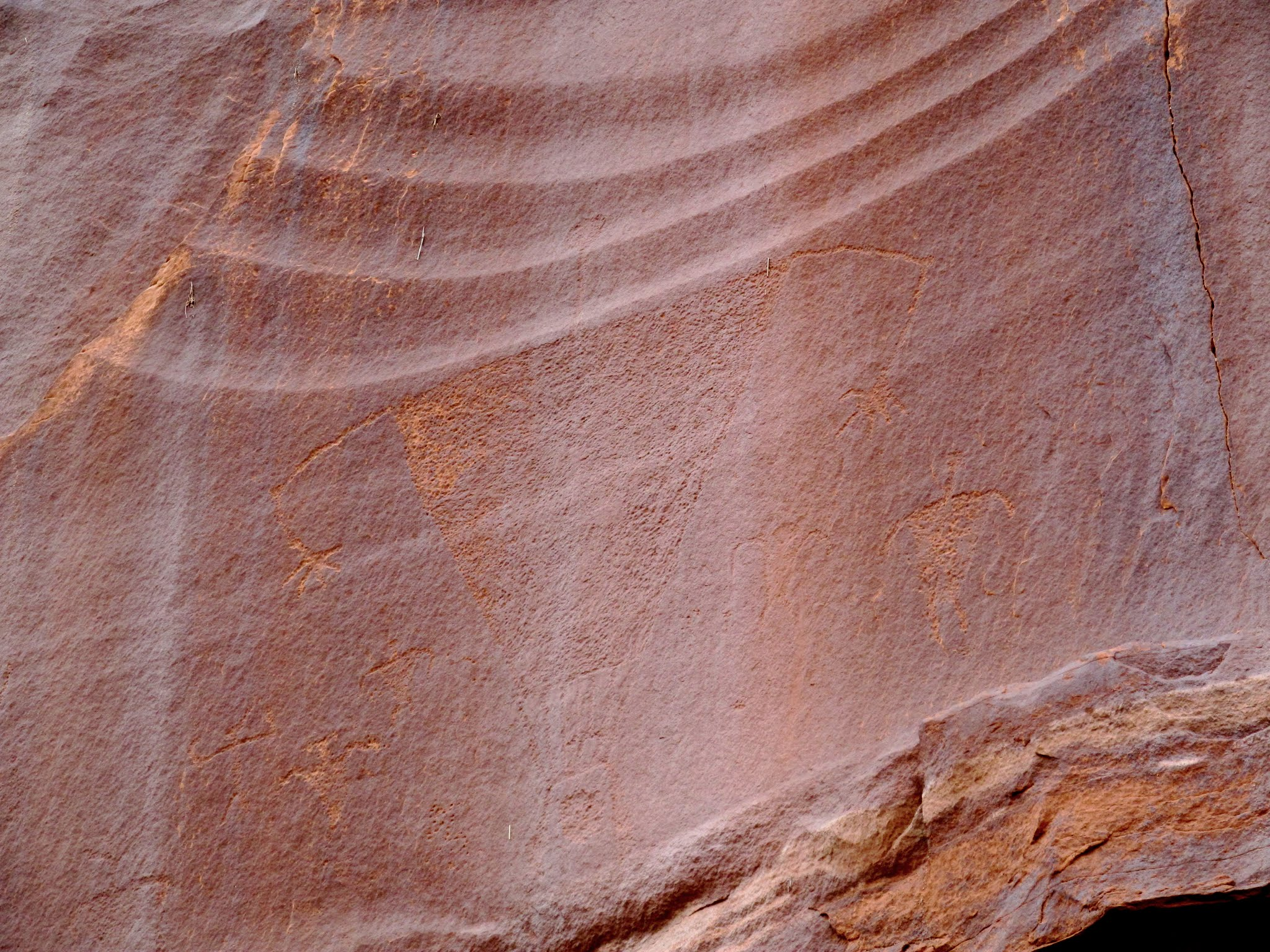 Photo: Large body and small head petroglyph