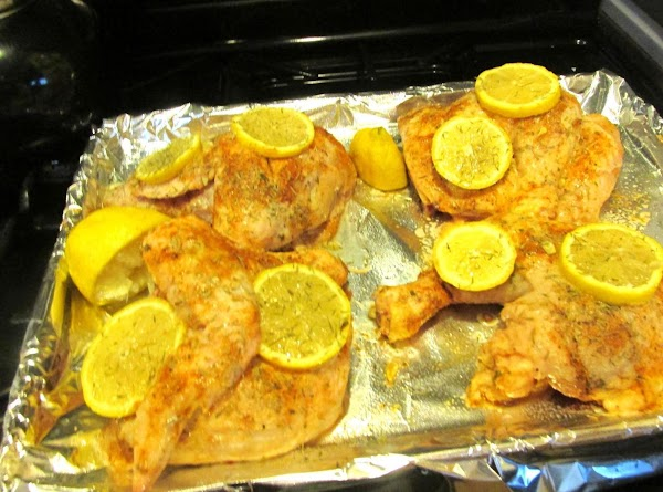 Add at least 2 slices of lemon on each piece of chicken. Then with...