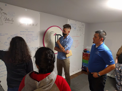 Discussing ideas at the whiteboard