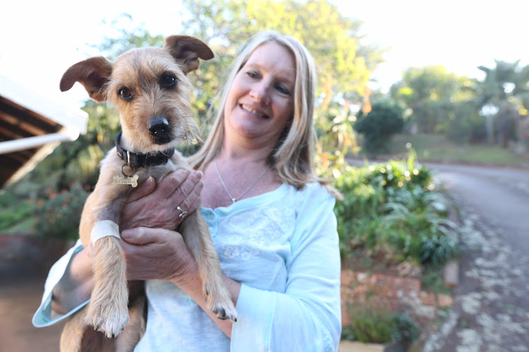 Morag Liebenberg with her lucky dog, Jasper, that killed a black mamba and survived the venom after having 4 vials of antivenom.