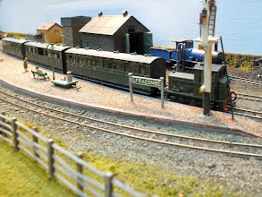 Photo: 118 The easily recognisable Austrian Roco 6 wheel diesel loco looks fine repainted into Southern Railway olive green and makes a very suitable station shunting locomotive .