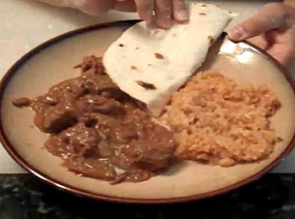 The final product sits with traditional Mexican rice and homemade flour tortillas. (Those recipes...
