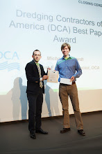 Photo: Closing Ceremony: Thijs van Kessel, Deltares, the Netherlands (right) receives the DCA Best Paper Award from Michael Gerhardt