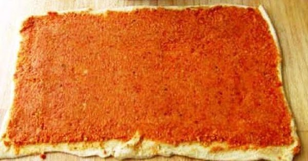 Spread a medium layer of pizza sauce over the top of each crescent dough...