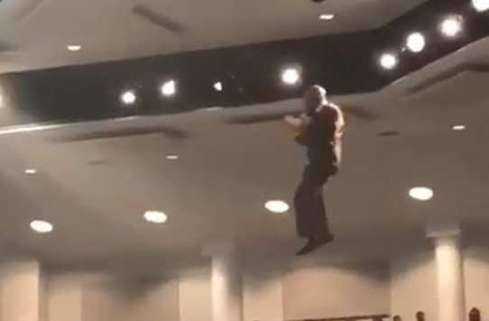 This pastor delivered his message while suspended from the ceiling during his Sunday sermon.