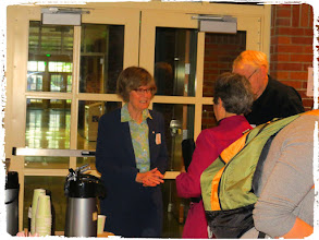 Photo: Dr. Nancy Reid talking with faculty
