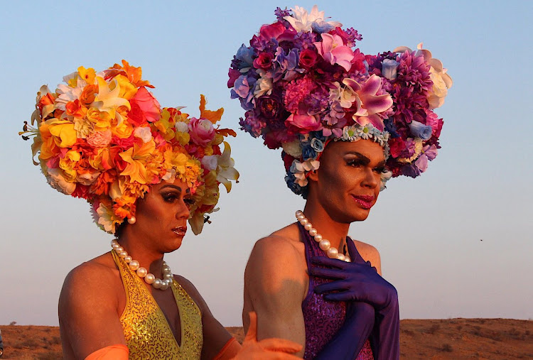 Drag queens stand together wearing during an official function for the annual Broken Heel Festival in an Australian outback town.