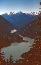 Photo: Ross Lake Recreation Area; Granite Creek Valley: 15. The Ross Lake Recreation Area is a narrow unit of one hundred thousand acres embracing three reservoirs in the North Cascades owned by Seattle City Light Company. The area is quite scenic and also takes in both sides of the north cross state highway, now under construction. This first view shows a view of Diablo Lake, a reservoir. Note carefully the forested appearance of the mountain plunging into Diablo Lake at the left. This is the route of the north cross state highway, and this picture was taken before the highway was built.