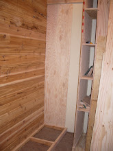 """Photo: Here you can also see the cutoff storage behind the plywood rack. Five shelves, 2' feet deep, ~6"""" wide, and ~18"""" high..."""